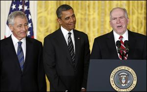 President Obama and his choice for Defense Secretary, former Nebraska Sen. Chuck Hagel, left, listen as the president's choice for CIA Director, Deputy National Security Adviser for Homeland Security and Counterterrorism, John Brennan, right, speaks at the White House Monday.