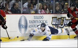 Walleye Randy Rowe, 18, dives after the puck. Rowe says he's still positive about Toledo's chances to be in the playoffs.