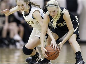 Abby Sattler, right, battles Northview's Lauren Keil. Sattler, a junior, averages 6.2 points per game.