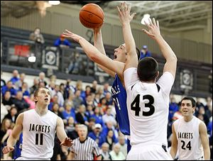 Anthony Wayne's Mark Donnal goes to the net against  Perrysburg's Nate Patterson.