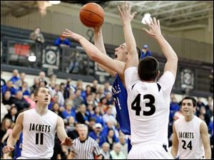 Anthony Wayne's Mark Donnal (34) goes to the net against  Perrysburg's Nate Patterson (43).