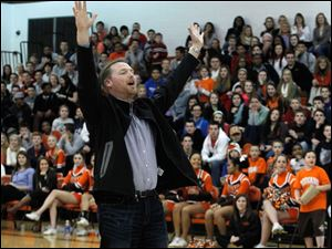 Jason Perry reacts to missing the basket during the half-court shot contest at half-time at the Northview vs. Southview game.