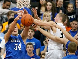 Anthony Wayne's Mark Donnal (34) battles Perrysburg's Shane Edwards (35) for a rebound.