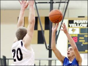 Anthony Wayne's Matt Fox (3) hits a three-point-shot against Perrysburg's Matt Kaczinski (20).