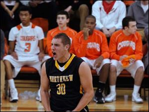 Northview's Nate Bartlett reacts to a three-pointer from a teammate against city rival Southview.