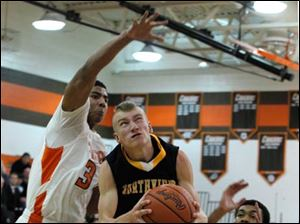 Northview's Adam Downing goes up between Southview's Nate Hall, left, and Jeremiah Roberts.