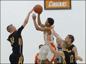 Northview player John Wendt, left, blocks ball of Cougar player Matt Morrison.