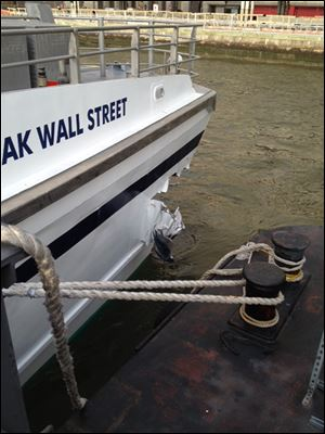 A hole is torn near the bow of the Seastreak Wall Street ferry after it banged into the mooring as it arrived at a pier in New York's financial district today.