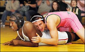 Clay's Eddie Silva, right, controls Central Catholic's Chris Norwood. Silva won.