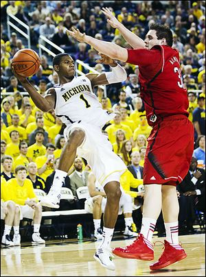 Michigan's Glenn Robinson III passes against Nebraska's Andre Almeida. The Wolverines play Sunday at Ohio State.