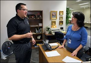 New Toledo city Councilman Shaun Enright meets Paula Howell, an administrative secretary in the council offices at One Government Center. Mr. Enright, 33, was appointed Tuesday to the seat Phil Copeland left.