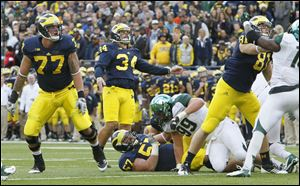 Michigan's Taylor Lewan decided to stay for his senior season instead of being a potential first-round pick in the NFL this spring.
