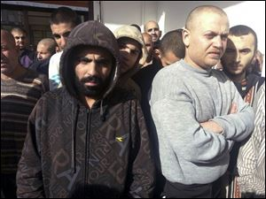Freed Syrian prisoners released by the Syrian government are seen in Damascus, Syria, today.