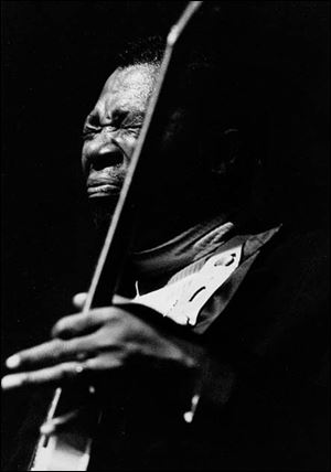 A performance by B.B. King is captured by internationally recognized photographer Baron Wolman. His images are on view at Owens Community College through March 28.