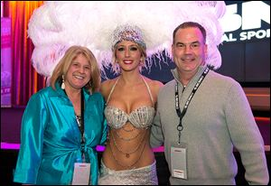 Laura and John Guitteau from WRK advertising pose with Jessica Bovia, center.