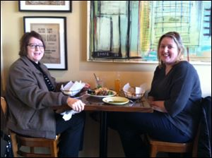 Mary Wabeke, left, of Sylvania, and Karen Wabeke, of Baltimore, Md., share a meal at Zingo's in Perrysburg.