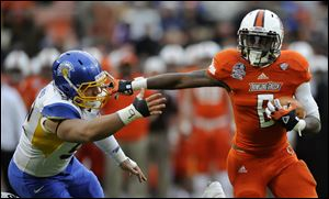 Bowling Green running back Anthon Samuel rushes against San Jose State defensive tackle David Catalano (92) during the Military Bowl last month in Washington.