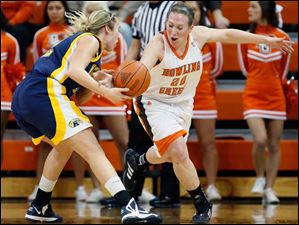 BGSU player Allison Papenfuss (20) steals the  ball from Kent State's Trisha Krewson (12).