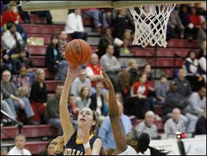 Notre Dame Academy player Christy Ohlinger shoots a layup over Central Catholic's Deonna Murdock.