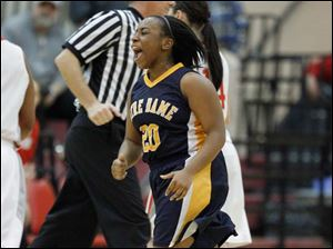 Notre Dame Academy player Faith Mitchell celebrates the win.