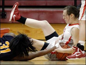Notre Dame Academy player Tierra Floyd, 31, and Central Catholic High School player Michelle Murnen battle for a loose ball.