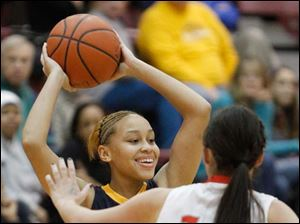 Notre Dame Academy player Destinee Battle, 10, looks to pass around Central Catholic High School player Jen Vliet.