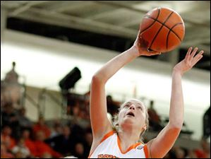 BGSU guard Miriam Justinger (30) takes a shot against against Kent State's Tamzin Barroilhet (14) at the Stroh Cener.