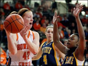 Falcons player Danielle Havel (42) looks for an opening against Kent State guard Ashley Evans (1).