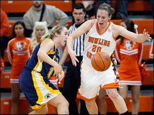 BGSU's Allison Papenfuss (20) steals the  ball from Kent State guard Trisha Krewson (12).