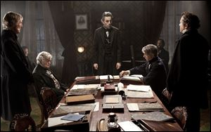Daniel Day-Lewis, center rear, as Abraham Lincoln, in a scene from the film, ""