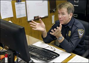 Steubenville police Chief William McCafferty sits behind a computer in his captains office as he tells how he gave the FBI an email that he had opened earlier which disabled his computer on Wednesday.