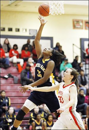Notre Dame's Tierra Floyd, left, is fouled by Central Catholic's Michelle Murnen during the fourth quarter Thursday night.