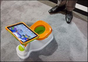 The iPotty for iPad potty training device is see on display at the Consumer Electronics Show, Wednesday, Jan. 9, 2013, in Las Vegas. No app is available to go with the trainer, but the idea is to keep the child on the toilet for as long as necessary by keeping them digitally entertained.