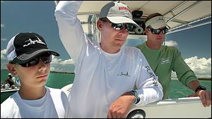 From left, Nate Meyer, Urban Meyer, and Mike Pawlawski fish off the Florida Keys in May. The fishing trip was part of the promise he made to his family before taking the Ohio State job.
