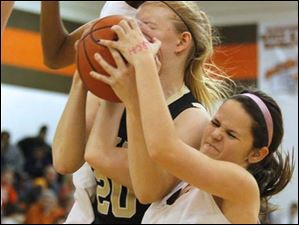 Southview's junior Jessica Horwitz (14) attempts to wrench a the ball out of the arms of Perrysburg's senior forward Samantha Gremler (20).