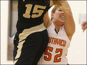 Perrysburg's senior forward Maddy Perry (15) battles for control of the ball with Southview's senior Madi Thomas (52).