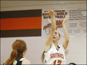 Southview's sophomore Maria Pappas (12) puts up a two-point field goal.
