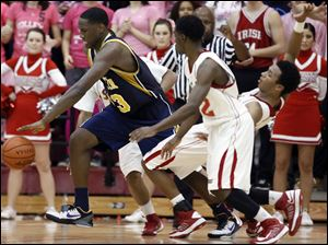Whitmer's Nigel Hayes (23) plows past Central Catholic's DeShone Kizer (14) and C.J. Bussey (12).