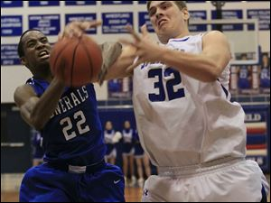 Anthony Wayne's #22, Ose Omofoma and Springfield's #32, Logan Weimer vie for the ball.