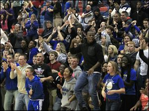 Springfield junior Tyson Proctor and other fans cheer as the team  faces Anthony Wayne.