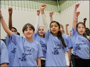 Students including, Kulsoom Ahmad, back left, Mason Narconi, front, left, Katelyn Imbrock, back, center, Aylia Naqvi, front, center, and Kimberly Parsons, front, right, sing a song called