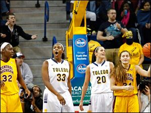 University of Toledo's center Yolanda Richardson (33) and Stephanie Recker (2) react to an official's call during the second half of Thursday evening's home game against Central Michigan University.