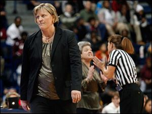 University of Toledo's head coach Tricia Cullop, left, walks away after conversing with a game official and Central Michigan University's head coach Sue Guevara, center, during the second half of Thursday evening's home game against Central Michigan University.