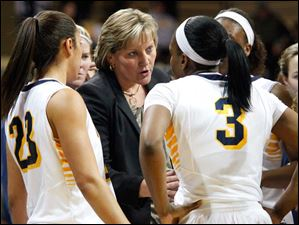 University of Toledo's head coach Tricia Cullop, center, talks to her team during a time out in the second half of Thursday evening's home game against Central Michigan University.