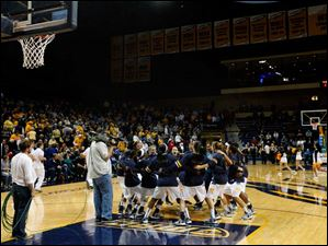 University of Toledo's women's basketball team pumps up before the start of Thursday evening's home game against Central Michigan University.