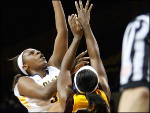 University of Toledo's Yolanda Richardson (33) attempts a layup during the second half of Thursday evening's home game against Central Michigan University.