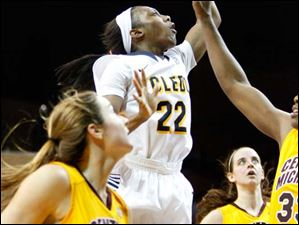 University of Toledo's guard Andola Dortch (22) puts up two points off a lane drive during the second half of Thursday evening's home game against Central Michigan University.