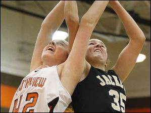 Southview's sophomore Emily Westphal (42) and Perrysburg's sophomore forward Allex Brown (35) fight to pull down a rebound.