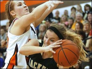 Southview's junior Taryn Stanley (32) puts pressure on Perrysburg's senior forward Maddy Perry (15).