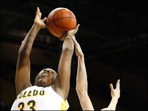 University of Toledo's center Yolanda Richardson (33) puts up two points off a rebound during the first half of Thursday evening's home game against Central Michigan University.